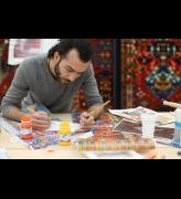 Faig Ahmed working in his studio in Baku, Azerbaijan. Image courtesy of the artist and Cuadro Gallery.