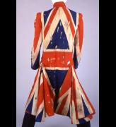 Jacket, 1996-97. Union Jack jacket designed by Alexander McQueen in collaboration with David Bowie, using distressed fabric. Worn by David Bowie on the Earthling album tour, 1996-97. Collection of David Bowie.