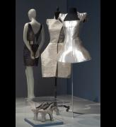 Dresses and shoes from the ARMOR section of the exhibition <em>Daphne Guinness</em> at The Museum at FIT. Photograph courtesy The Museum at FIT.