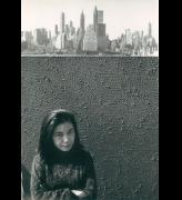 Yayoi Kusama with net painting and skyline in New York, c1961.