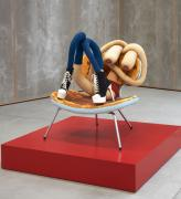 Sarah Lucas, Cool Chick Baby, 2020. Tights, wire, kapok, shoes, acrylic paint, vinyl and metal chair, 96.5 x 77.5 x 90 cm plus 20.3 x 121.9 x 121.9 cm. Image courtesy of Sadie Coles HQ. © Sarah Lucas, courtesy Sadie Coles HQ, London. Photo: Robert Glowacki.