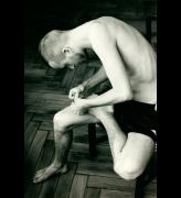 Wolfgang Tillmans. <em>Anders pulling splinter from his foot,</em> 2004. C-type print, 61