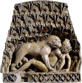 Ivory plaque of a lioness mauling a man. Ivory, gold, cornelian, lapis lazuli, Nimrud, 900BC – 700BC. © The Trustees of the British Museum.