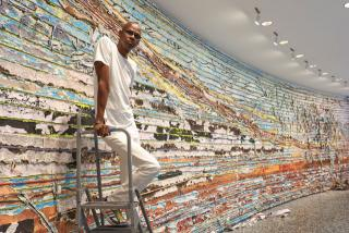 Mark Bradford at the Hirshhorn Museum and Sculpture Garden with details of Pickett's Charge, 2017. Courtesy of the artist and Hauser & Wirth. Photograph: Cathy Carver.