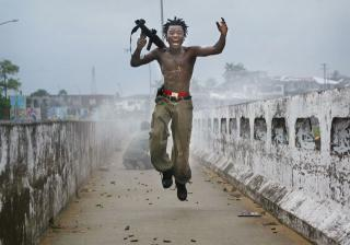 Chris Hondros. Photograph of Joseph Duo (2003), the commander of a band of child soldiers in the army of the then Liberian president, Charles Taylor. Courtesy Sunshine Sachs/Getty Images.