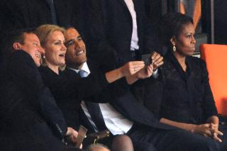 Helle Thorning-Schmidt, the Danish prime minister, took a selfie of herself with President Barack Obama and UK prime minister David Cameron at the Nelson Mandela memorial, December 2013. Courtesy ROBERTO SCHMIDT/AFP/Getty Images.
