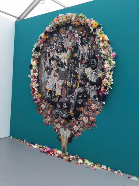 Ebony G. Patterson. Wi oh so clean. From the Family Series, Mixed media photo tapestry, with flowers. Installed at Untitled. Photograph: Jill Spalding.