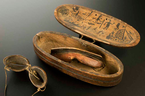 R for RESOURCEFULNESS. Inuit snow goggles and wooden case decorated with hunting scenes. Carved wood and rawhide, 19th century © Science Museum/Wellcome Collection. Goggles such as these were invented by the Inuit people of North America about 2,000 years ago to protect wearers against snow blindness.
