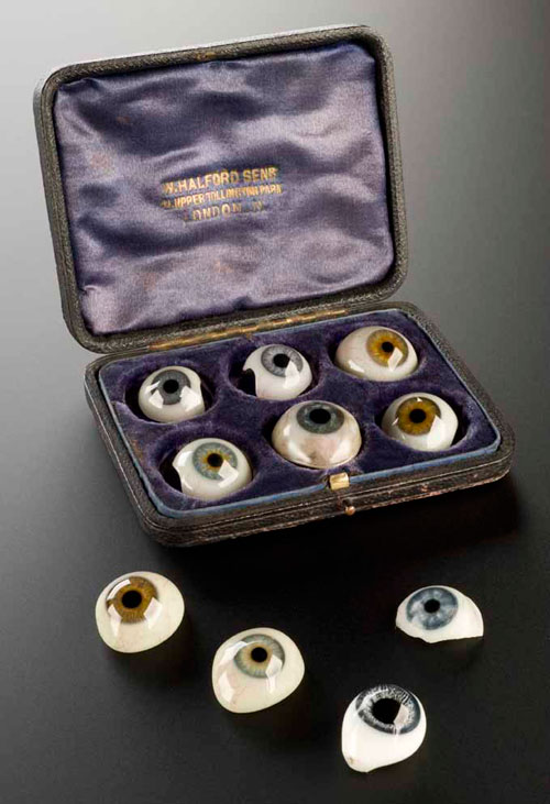 R for RESOURCEFULNESS. A case of false eyes. White glass with blood vessels in red and a variety of coloured lenses. Made by W. Halford of London. English, c1890 © Science Museum/Wellcome Library.