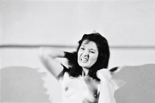 Marina Abramović. <em>Art Must Be Beautiful, Artist Must Be Beautiful</em>. Performed in 1975 for one hour at Charlottenburg Art Festival, Copenhagen