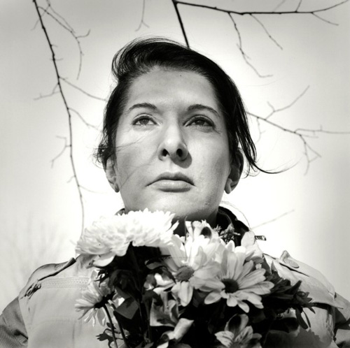 Marina Abramović. <em>Portrait with Flowers</em>, 2009. Black-and-white gelatin silver print; photo: Marco Anelli.