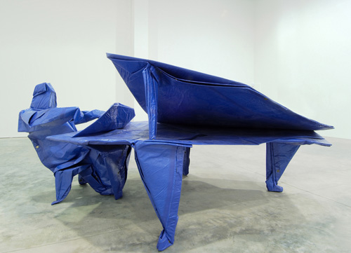 Matt Johnson. <em>The Pianist (after Robert J. Lang)</em> 2005. Blue tarp, paper, stainless stee,l 147x 340 x 198cm. Courtesy of the Saatchi Gallery, London. &copy;Matt Johnson, 2009.