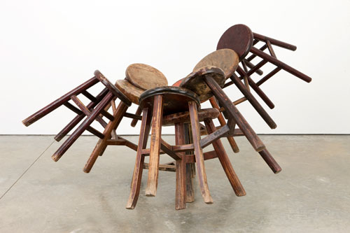 Ai Wei Wei. Grapes, 2008. Ten Qing Dynasty (1644-1911) stools, 92 x 172 x 153 cm. Courtesy of the artist; Friedman Benda, New York. Photograph: Bill Orcutt.