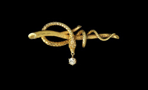 Designer unknown, USA. <em>Serpent</em> c. 1860. 18kt yellow gold, diamond. 2.4 x 1.1 inches.  Photo: John Bigelow Taylor.
