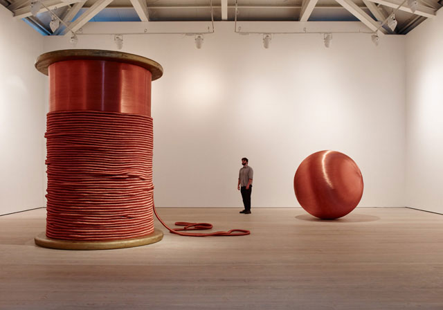 Alice Anderson. Left: Bound, 2011. Bobbin made of wood and copper thread, 345 x 248 x 248 cm. Right: 181 Kilometers, 2015. Sculpture made after performances, copper thread 200 cm (diameter). Photograph © Steve White, 2015. Courtesy of the Saatchi Gallery, London.