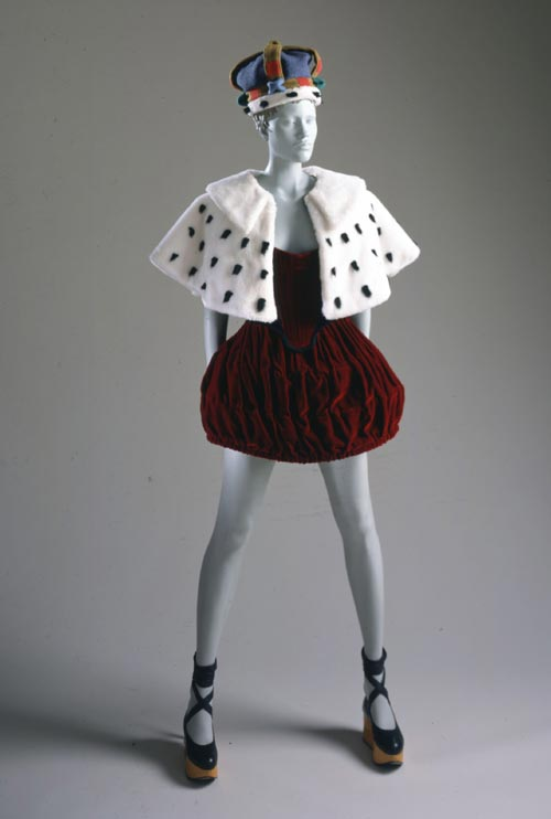 Queen-ish Ensemble. Vivienne Westwood (British, b. 1941). Harris Tweed collection autumn/winter 1987-88. Burgundy cotton velvet with blue wool piping; faux ermine fur; black leather and natural wood; faux ermine fur and multicolored felted wool crown. Los Angeles County Museum of Art, Costume Council Fund, M.2002.97a-f. Photography © 2002 Museum Associates/LACMA.