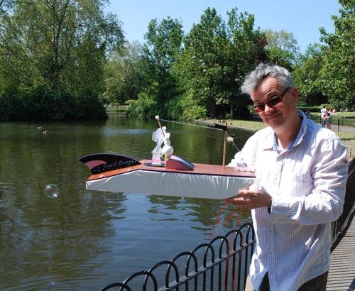 <p>Kit Poulson with boat made by Kit Poulson, Edwina Ashton and Mirabel Ashton-Poulson, 2012.