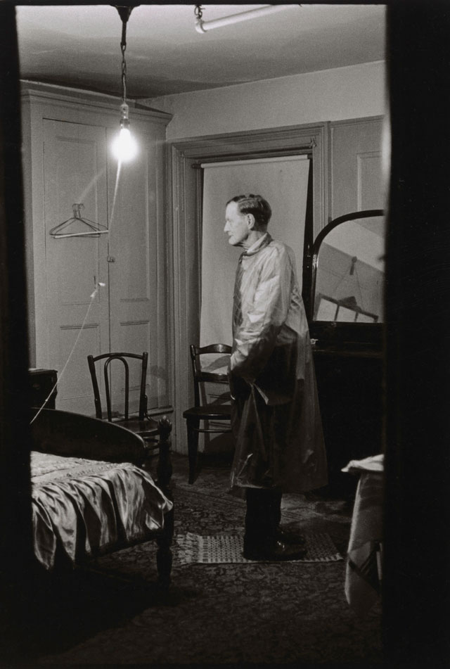 Diane Arbus. The Backwards Man in his hotel room, N.Y.C. 1961. © The Estate of Diane Arbus, LLC. All Rights Reserved.