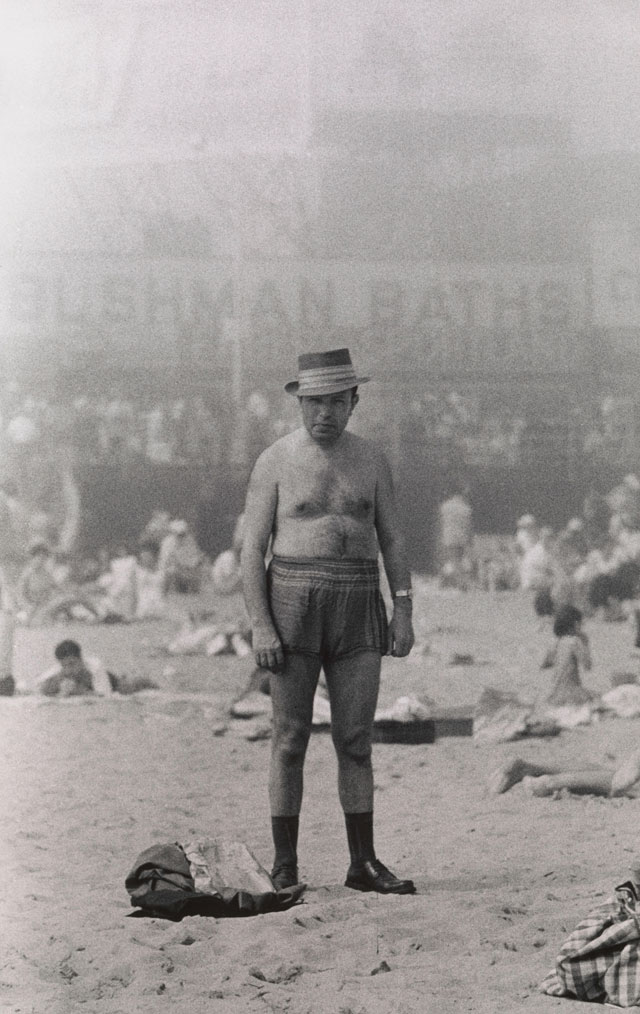 Diane Arbus. Man in hat, trunks, socks and shoes, Coney Island, N.Y. 1960. © The Estate of Diane Arbus, LLC. All Rights Reserved.