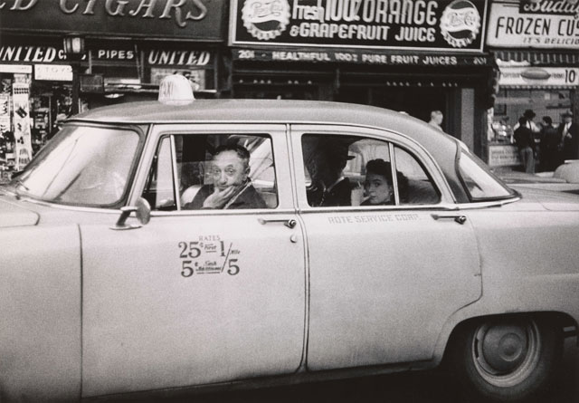 Diane Arbus. Taxicab driver at the wheel with two passengers, N.Y.C. 1956. © The Estate of Diane Arbus, LLC. All Rights Reserved.