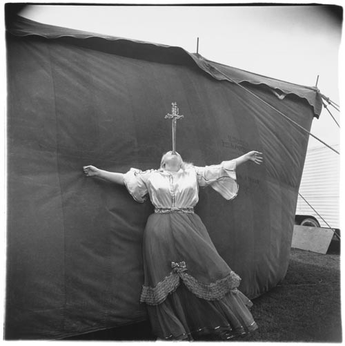 Albino sword swallower at a carnival, Md. 1970. Copyright © 1972 The Estate of Diane Arbus, LLC