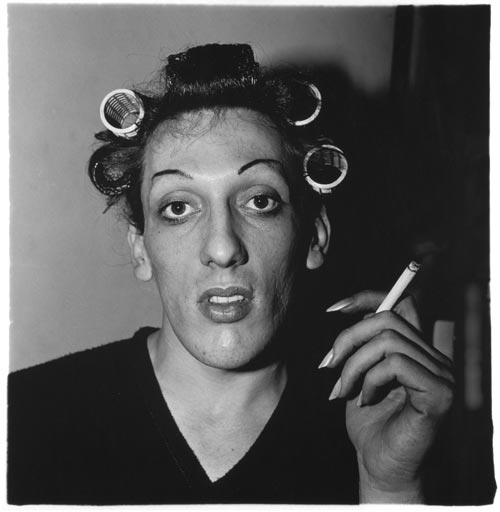 A young man in curlers at home on West 20th Street, N.Y.C. 1966. Copyright © 1972 The Estate of Diane Arbus, LLC