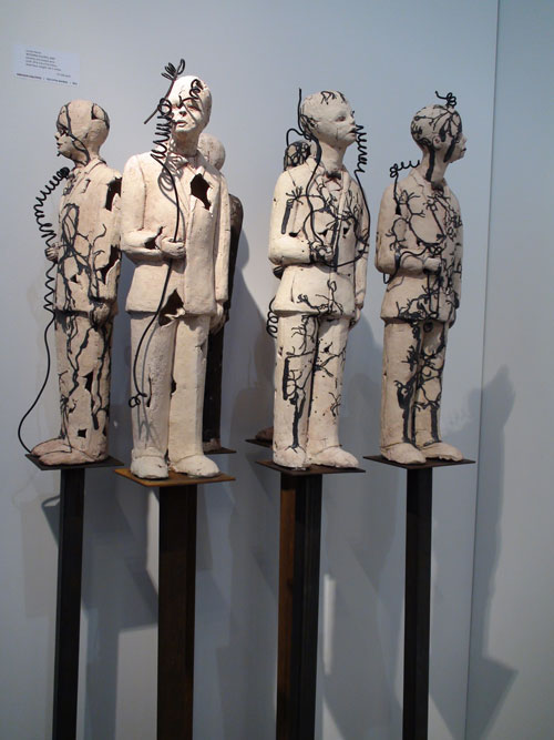 Varda Yatom. <em>Wedding Figures</em>, 2003. Ceramic and coated wire, 20 x 5¾ x 3¾ in. Babcock Galleries. Photograph: Miguel Benavides.