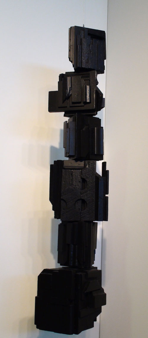 Louise Nevelson. <em>Rain Forest,</em> c1967. Wood, painted black, with hanging moveble elements, 40½ x 10 x 10 in. Hirschl & Adler Modern. Photograph: Miguel Benavides.