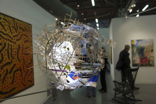 Sarah Sze. Untitled, 2013. Mixed media, lamp, tripod, toothpicks, egg shells, string, 171.4 x 78.7 x 58.4 cm.