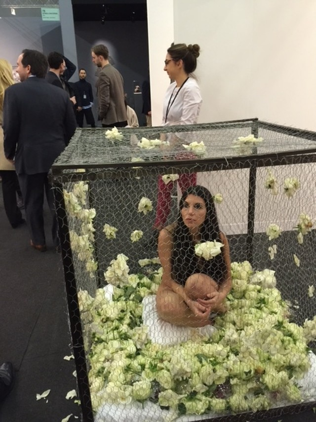 Romina de Novellis. Nude in a cage with roses, 2015. Photograph: Jill Spalding.
