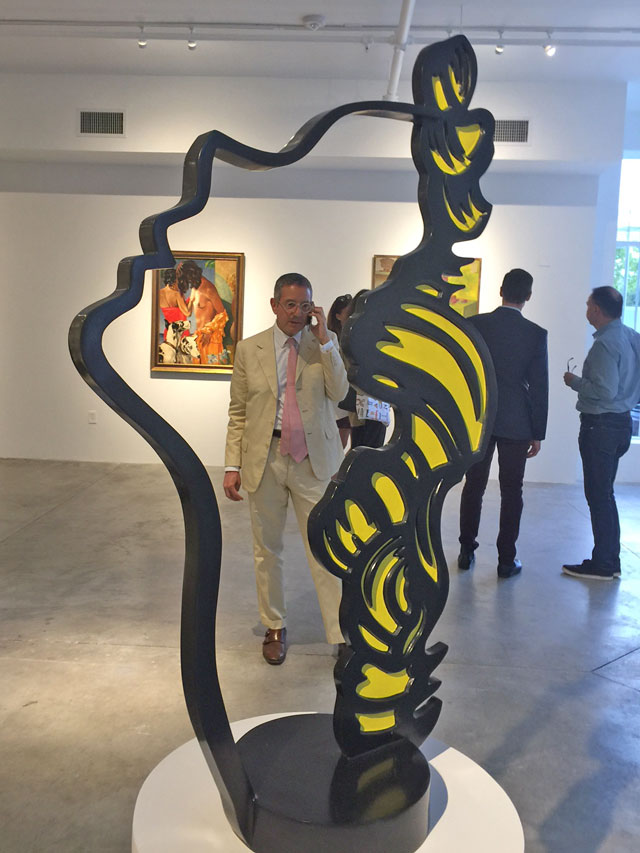 Jeffrey Deitch on cellphone as seen through the Lichtenstein. Photograph: Jill Spalding.