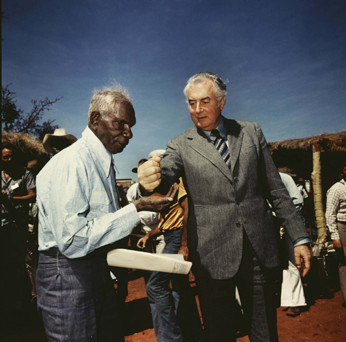 <p>Mervyn Bishop. <em>Prime Minister Gough Witlam pours soil into the hands of traditional land owner Vincent Lingiari, Northern Territory 1975</em>, 1999. Type R3 photograph, 30.5 x 30.5 cm.