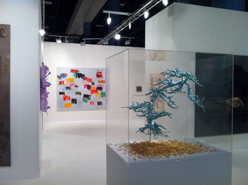 Installation view of Galerie Lelong's booth at Art Basel Miami Beach 2012. Works clockwise from left: Lavender Heart (2012), Lin Tianmiao; Untitled (2009), Günther Förg; Untitled (1958). Hélio Oiticica; Male Bomb (1966), Nancy Spero; Untitled (2002), Jannis Kounellis; Untitled (Bonsai Tree) (2012), Lin Tianmiao. Courtesy Galerie Lelong, New York & Paris.