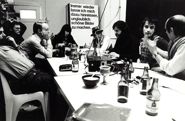 Colloquium held at Dieter Hacker's Studio (left to right: Gerhard Steidl, Dieter Hacker, Klaus Staeck, Caroline Tisdall, Joseph Beuys, Christos Joachimides, Norman Rosenthal, KP Brehmer), Berlin, 26-27 April 1974