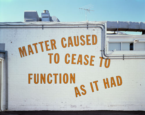 Lawrence Weiner. <em>MATTER CAUSED TO CEASE TO FUNCTION AS IT HAD</em>, 1995. Language and the materials referred to, dimensions variable. Installation view, Regen Projects, Los Angeles, 1995. Courtesy Regen Projects, Los Angeles. Copyright © Lawrence Weiner.