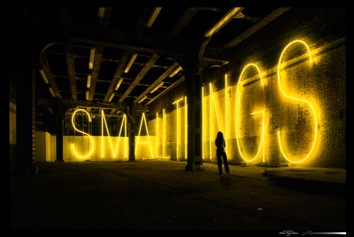 Martin Creed. <em>Work No. 755: SMALL THINGS</em>, 2007 Gold neon sign, 16-foot high letters. Courtesy Gavin Brown's enterprise, New York.