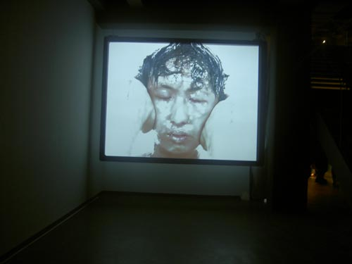 Owen Leong. <em>Second Skin</em> 2004 (digital video).