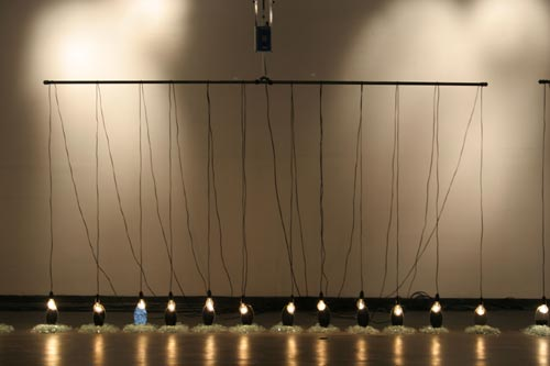 Suzann Victor. <em>Expense of Spirit in a Waste of Shame </em>2002. Light bulbs, mirrors, cables, mechanical rockers, control unit, broken glass.