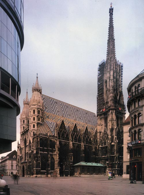 The St Stephens Cathedral, Vienna, faced by the Haas Haus Centre. Architect Professor Hans Hollein (1983).