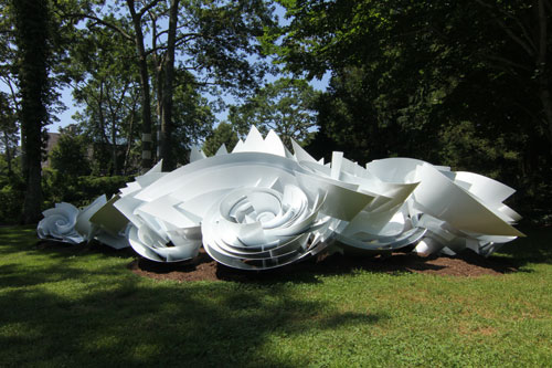 Alice Aycock. Maelstrom (Module 3), 2013. Painted aluminum; 6' tall x 30' wide x 30' long. Edition of 2. The sculpture is part of the full scale Maelstrom. Temporary installation at LongHouse Reserve, East Hampton, NY, July-Oct. 2013. Courtesy Alice Aycock / PAPC & Galerie Thomas Schulte, Berlin. Photograph: Dave Rittinger.