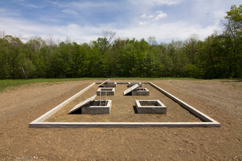 Alice Aycock. A Simple Network of Underground Wells and Tunnels, 1975/2012. Concrete, wood, earth, approximately 28' x 50' x 9' deep. Originally sited at Merriewold West, Far Hills, New Jersey, (destroyed); Permanently reconstructed at The Fields Omi/Architecture Omi, Ghent, NY, 2011. Photograph: Dave Rittinger.