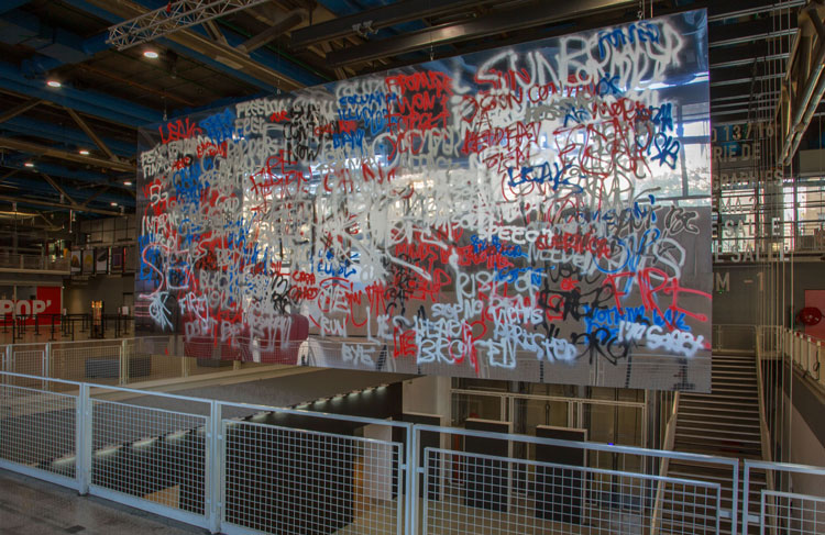 Stefan Brüggemann. Headlines and Last Lines in the Movies (Guernica), 2019. Alupanel, aluminium, spraypaint, 349 x 777 cm (137 3/8 x 305 7/8 in). Installation view, Extra! Festival, Centre Pompidou, Paris. © Stefan Brüggemann. Courtesy the artist and Hauser & Wirth.