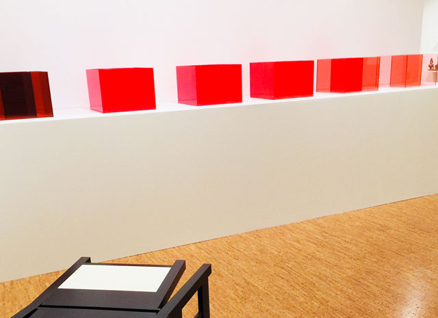 Larry Bell, Pacific Red, 2017. Red laminated glass, installation view, The Bunker Artspace, West Palm Beach, Florida. Photo: Jill Spalding.