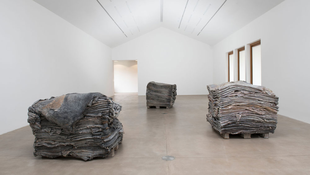 In two powerful sets of new work at Hauser & Wirth's Somerset outpost, the Belgian sculptor moves beyond her figurative past in an attempt to capture the tragedy of the present day