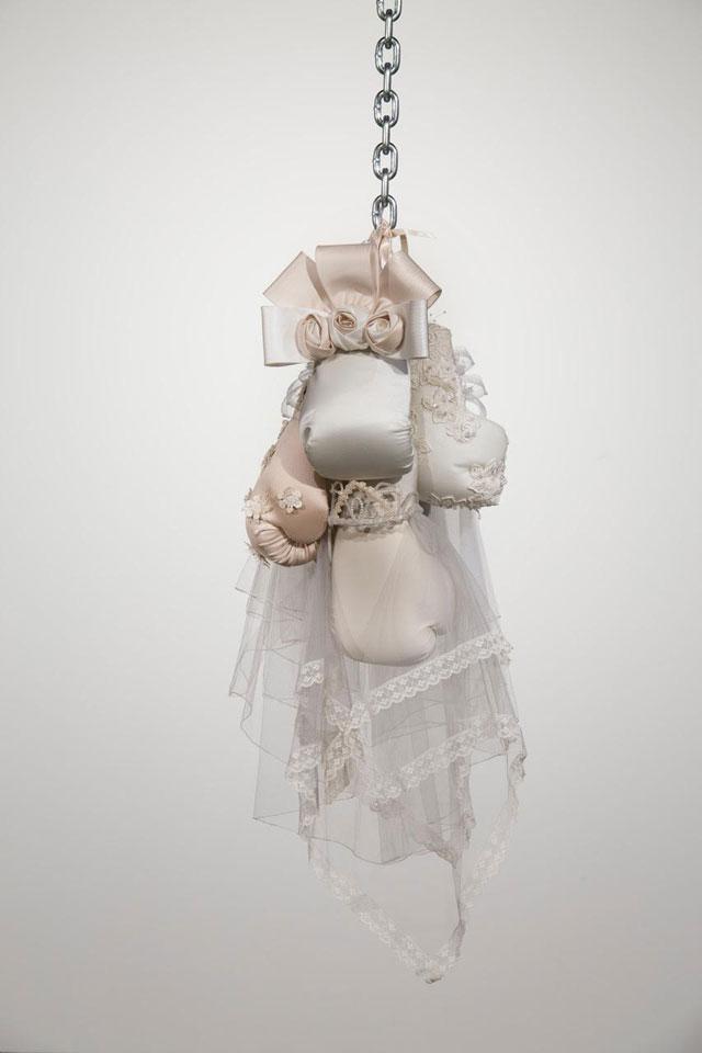 Zoe Buckman. Ode On, 2016. Chain, boxing gloves and embroidery on vintage wedding dresses, 41 x 16 x 17 in. Courtesy the artist and 21c Museum.
