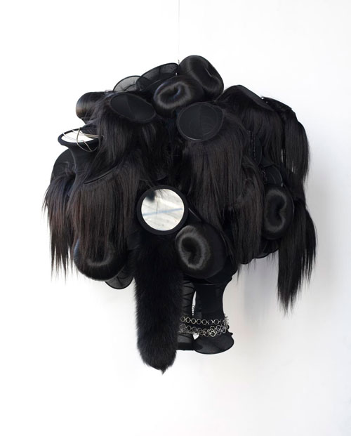 Nina Lola Bachhuber. Untitled, 2008. Coil springs, tights, hair, fox tail, mirrors, necklaces, 71 x 76.2 x 88 cm.