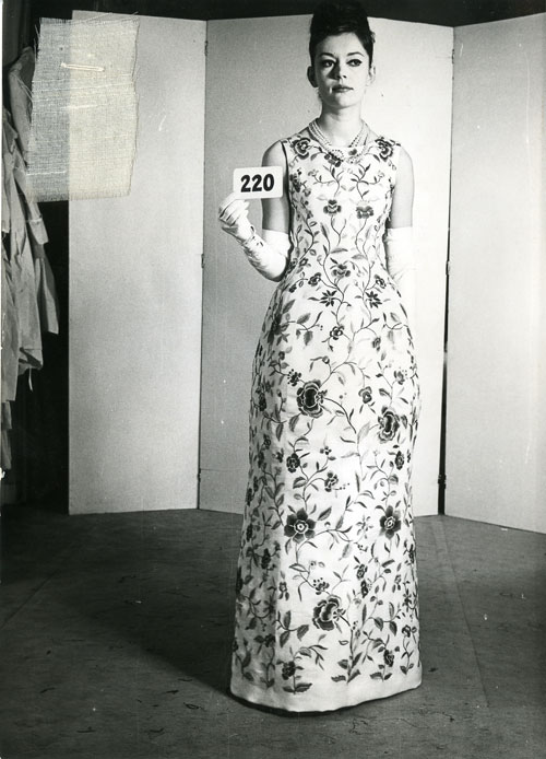 Cristobal Balenciaga. House photograph of evening dress of ivory silk with polychrome silk floral embroidery by Lesage, summer 1960. Courtesy Balenciaga Archive.