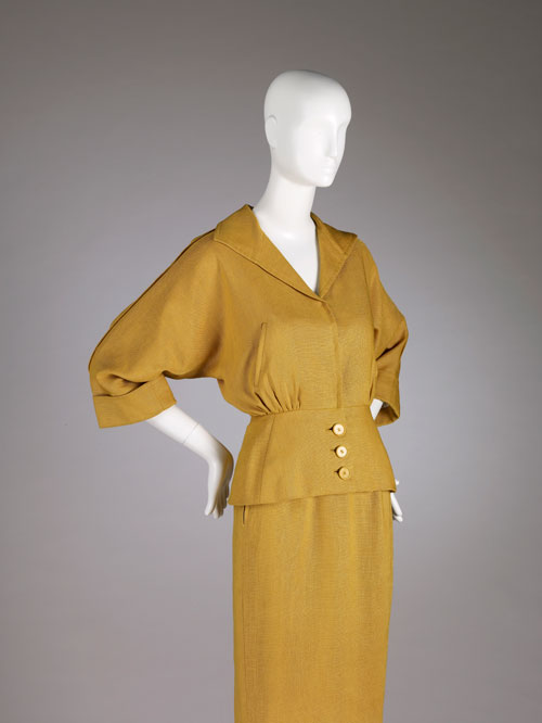 Cristobal Balenciaga. Suit of mustard-yellow linen, summer 1950. Collection of Hamish Bowles. Photo by Joe McDonald/Fine Arts Museums of San Francisco.