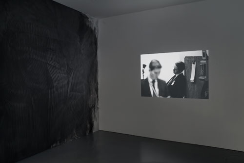 Fiona Banner in collaboration with Paolo Pellegrin and in association with the Archive of Modern Conflict. Mistah Kurtz – He Not Dead installation view at PEER, 2014. Photograph: FXP Photography.