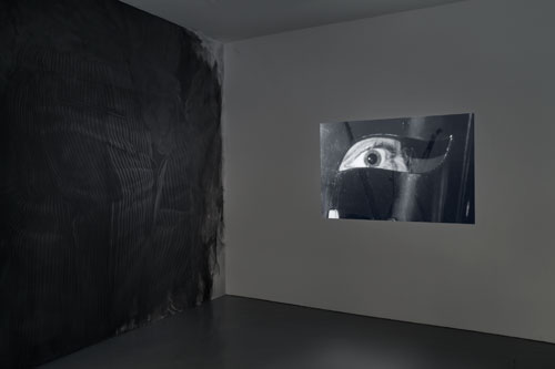 Fiona Banner in collaboration with Paolo Pellegrin and in association with the Archive of Modern Conflict. Mistah Kurtz – He Not Dead installation view at PEER, 2014 (2). Photograph: FXP Photography.